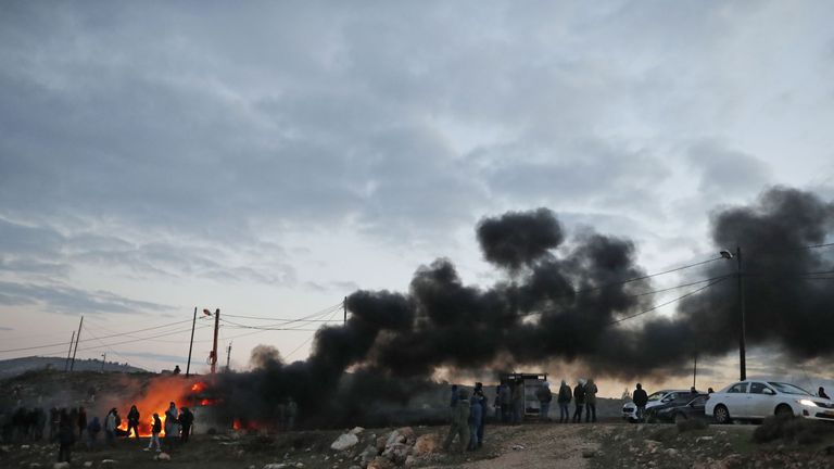 Jewish settlers set tyres ablaze at the Amona outpost