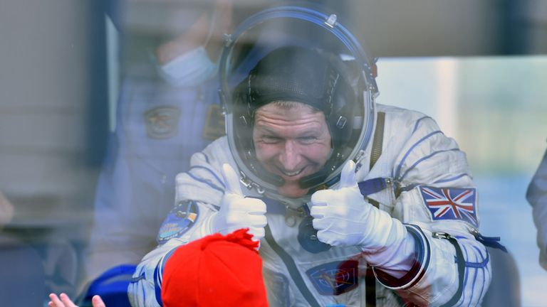 Tim Peake gives a thumbs up to his child before blast-off to the ISS in 2015