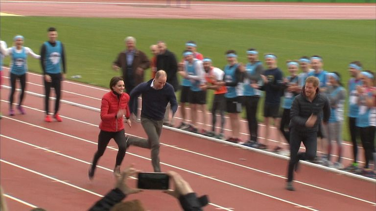 The Duke and Duchess of Cambridge and Prince Harry take part in a 100 metre relay sprint