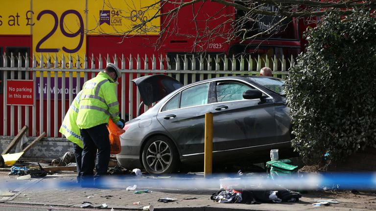 The car is believed to have ploughed through a row of bollards before hitting a low wall at the end of a hedge
