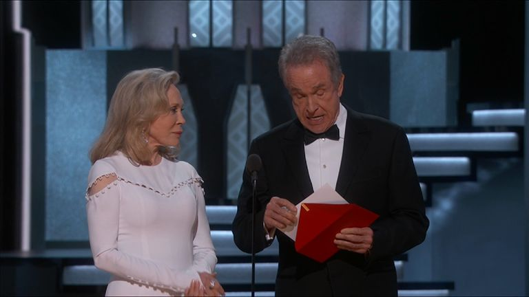 Beatty looks at the content of the envelope twice in confusion