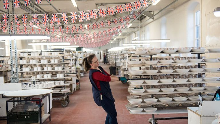 Hand-painted crockery is moved on trollies in the Emma Bridgewater factory, which employs around 185 people and manufactures 1.3 million pieces of pottery each year in the centre of Stoke-on-Trent, central England on February 14, 2017