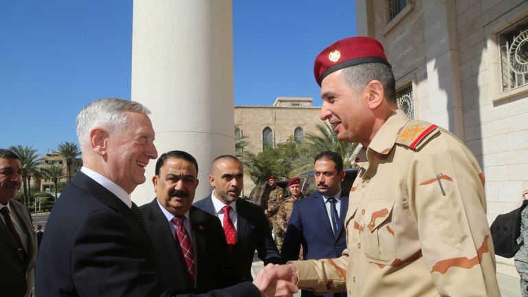 Iraqi Chief of Staff General Othman al-Ghanimi welcomes U.S. Defense Secretary Jim Mattis