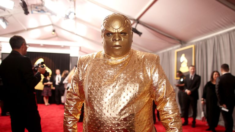 CeeLo Green showed up as a metallic gold something with a strange headpiece and tunic to match