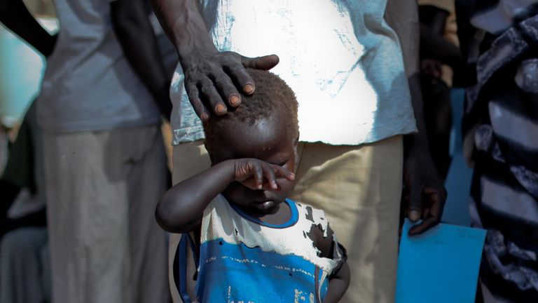 A boy who fled a war across the border in Sudan's Blue Nile state waits in a queue outside a clinic in Doro refugee camp, March 9, 2012