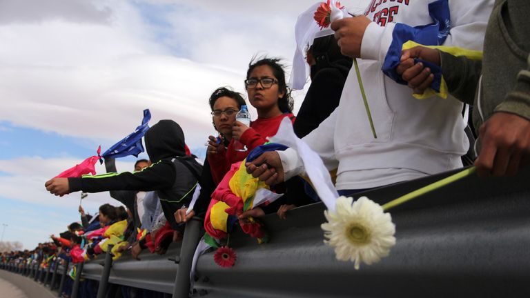 People from Ciudad Juarez carrying flowers protest against the politics of US President Donald Trump along the Rio Bravo, in the border between Ciudad Juarez and El Paso, Texas, in Ciudad Juarez, Mexico on February 17, 2017. The event consisting of a human fence was also held at the Tijuana-San Diego border
