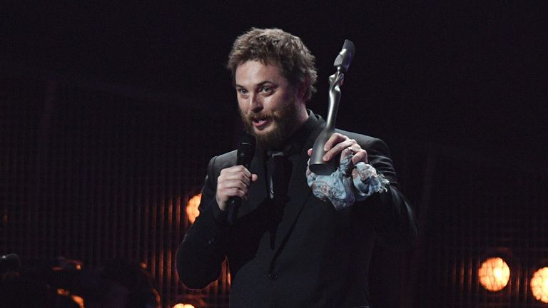 Duncan Jones accepts his father's album of the year award