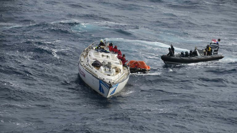 The Clyde Challenger and her crew being rescued by a team from the Royal Navy's HMS Dragon. Pic: Royal Navy