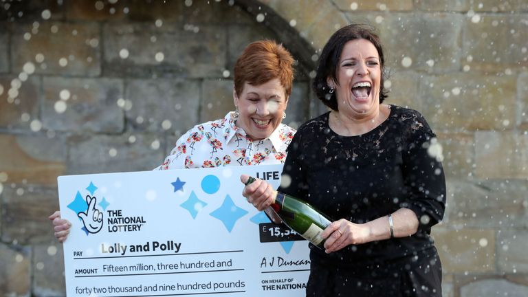 Two best friends Paula Barraclough, 45 (right), and Lorraine Smith, 54, from Tyne and Wear celebrate their win