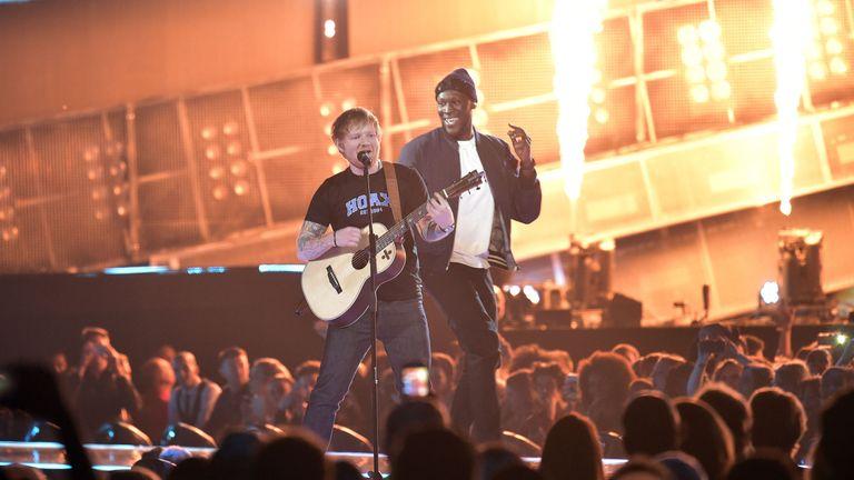 Ed Sheeran performing on stage at the Brit Awards at the O2 Arena