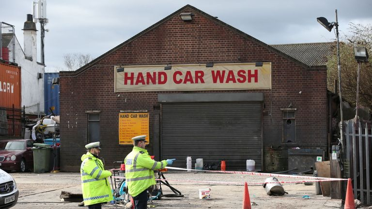 The crash took place close to a manual car wash and opposite a row of shops