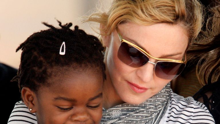 Madonna in 2010 with her adopted Malawian child Mercy James. File Pic