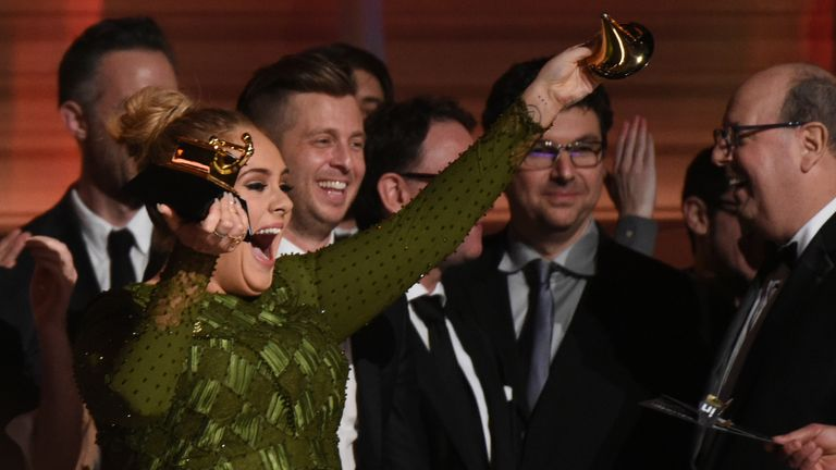 Adele breaks her Grammy in two after she praises Beyonce in her acceptance speech. Pic: Getty