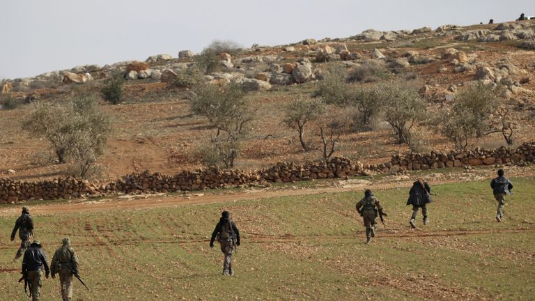 Free Syrian Army fighters are seen in al Baza'a village in the outskirts of al-Bab town