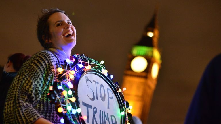 An anti-Trump protester demonstrates outside Parliament