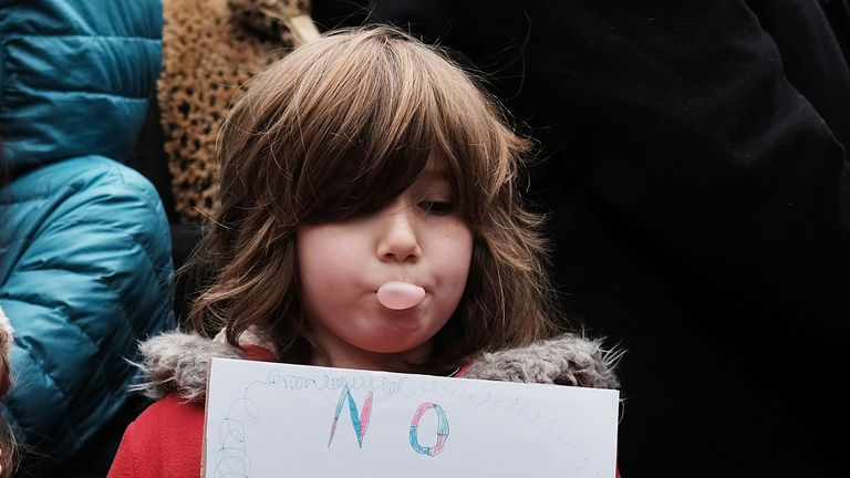 A child pauses during an anti-hate rally at a Brooklyn park named in memory of Beastie Boys band member Adam Yauch after it was defaced with swastikas on November 20, 2016 in New York City