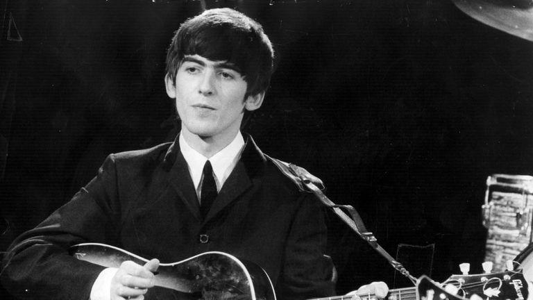 George Harrison performing with The Beatles in 1963