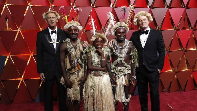 Directors Martin Butler (L) and Bentley Dean (R) pose with cast members from Australia's best foreign language film nominee Tanna