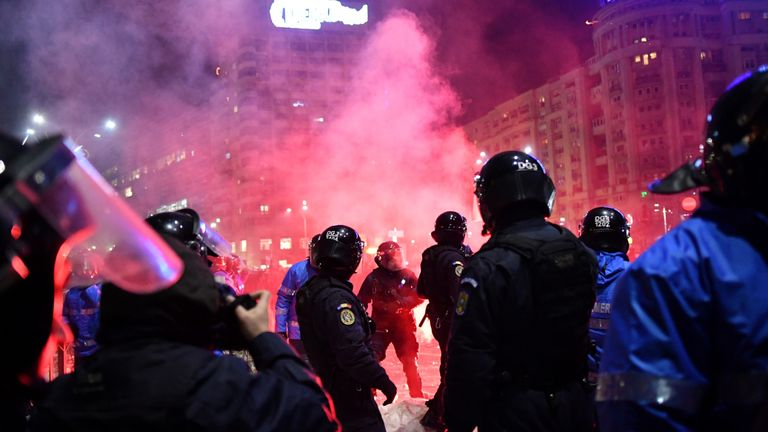 Romanian riot police clash with protesters during a demonstration