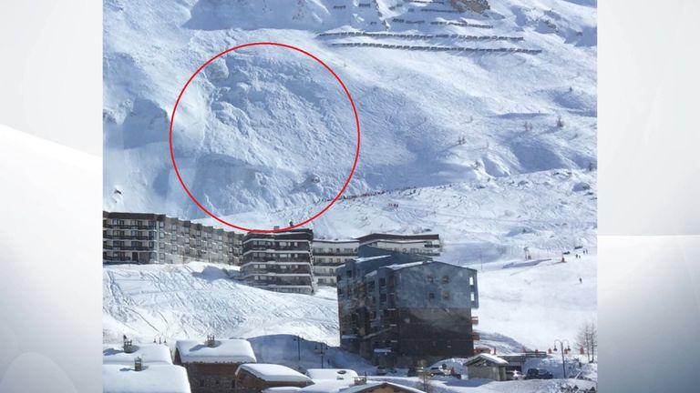 An avalanche strikes near the French ski resort of Tignes