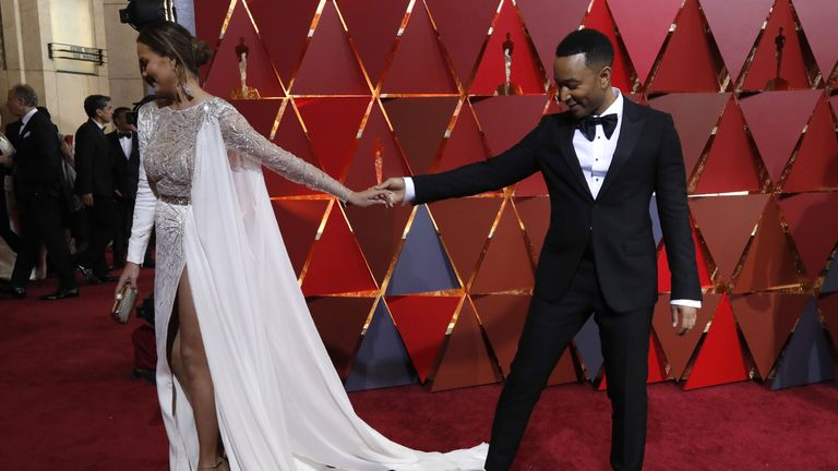 Model Chrissy Teigen arrives with husband, singer John Legend