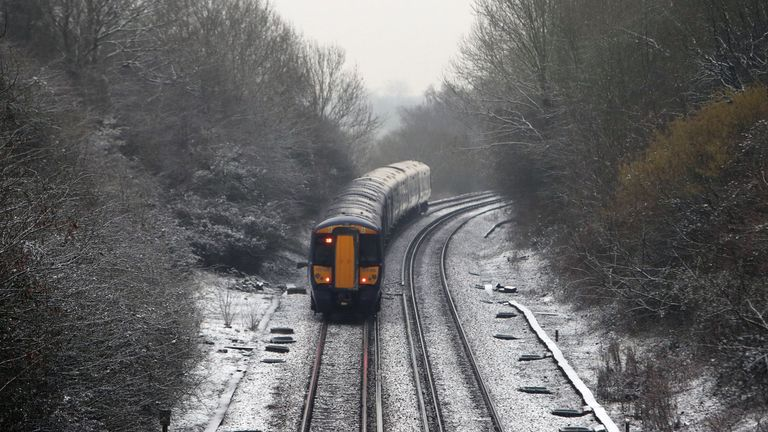 A train makes its way past a dusting of snow near Westwell Leacon, Kent