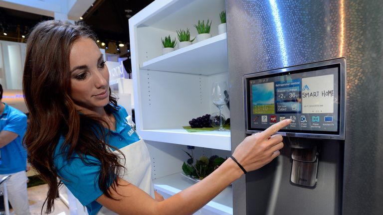 A model shows off a Samsung smart fridge at the 2014 Consumer Electronics Show
