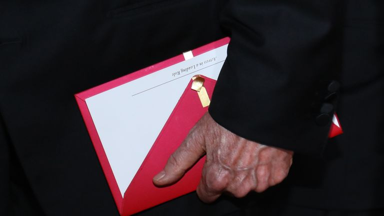 Presenter Warren Beatty holding the original envelope he was handed by mistake