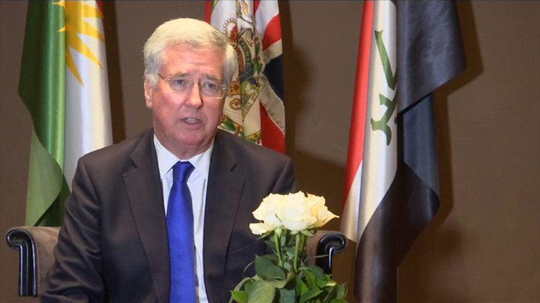 Sir Michael Fallon talks to reporters in Baghdad, Iraq
