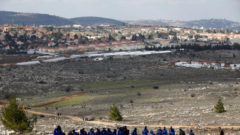 Israeli policemen gather as they prepare to evict residents of the Israeli settler outpost of Amona