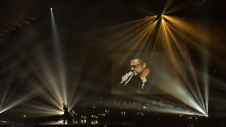 Chris Martin performs a tribute to George Michael on stage at The BRIT Awards 2017