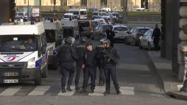 Armed police outside the Louvre in Paris following the incident