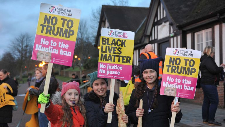 Amelia Wesley (10), Evie Smith (10) and Grace Smith (12) from Nottingham protesting against Donald Trump