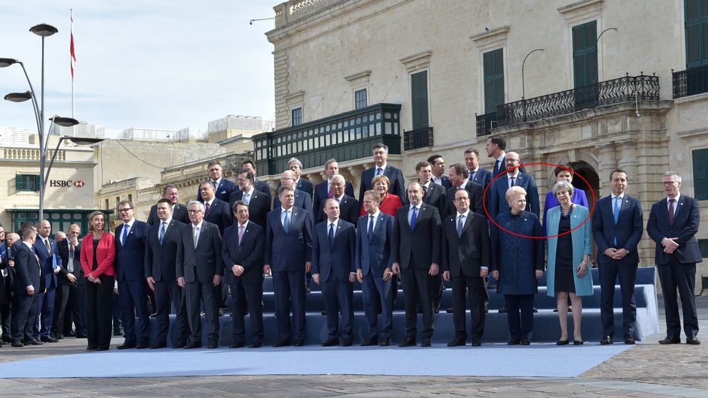Mrs May stands next to Dalia Grybauskaite in the 'family' photo of EU leaders at the summit in Malta