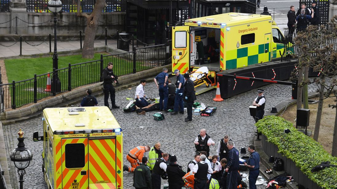 Emergency services attend a man outside the Palace of Westminster
