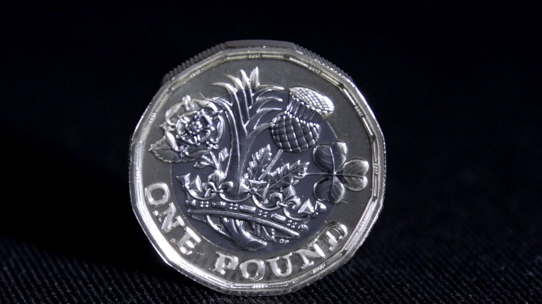 The new pound coin will have sides and be two different colours