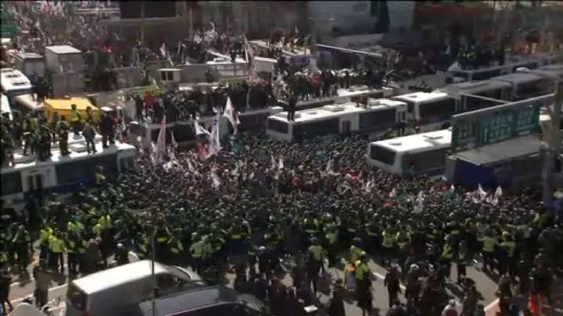 Police surround demonstrators outside the Constitutional Court in Seoul