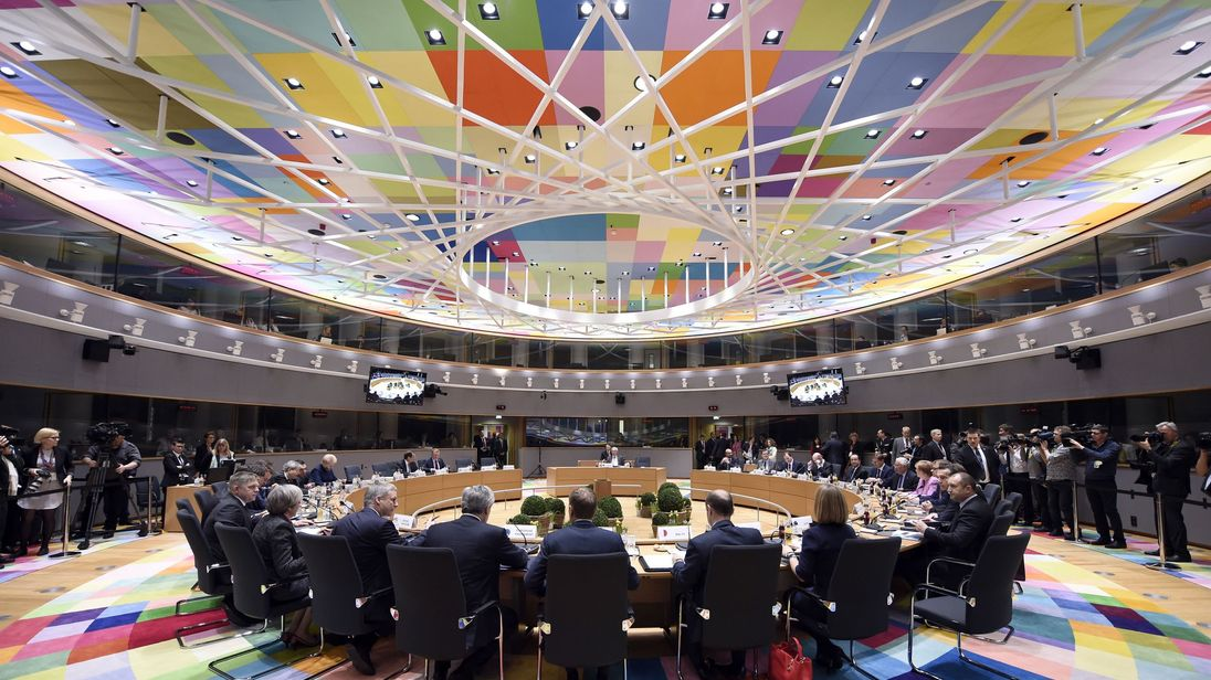 European leaders arrive for a meeting in the council room at the new Europa building