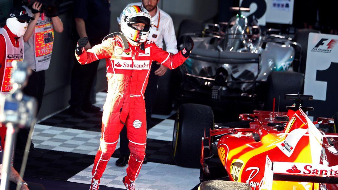 Ferrari driver Sebastian Vettel of Germany celebrates after winning the Australian Grand Prix