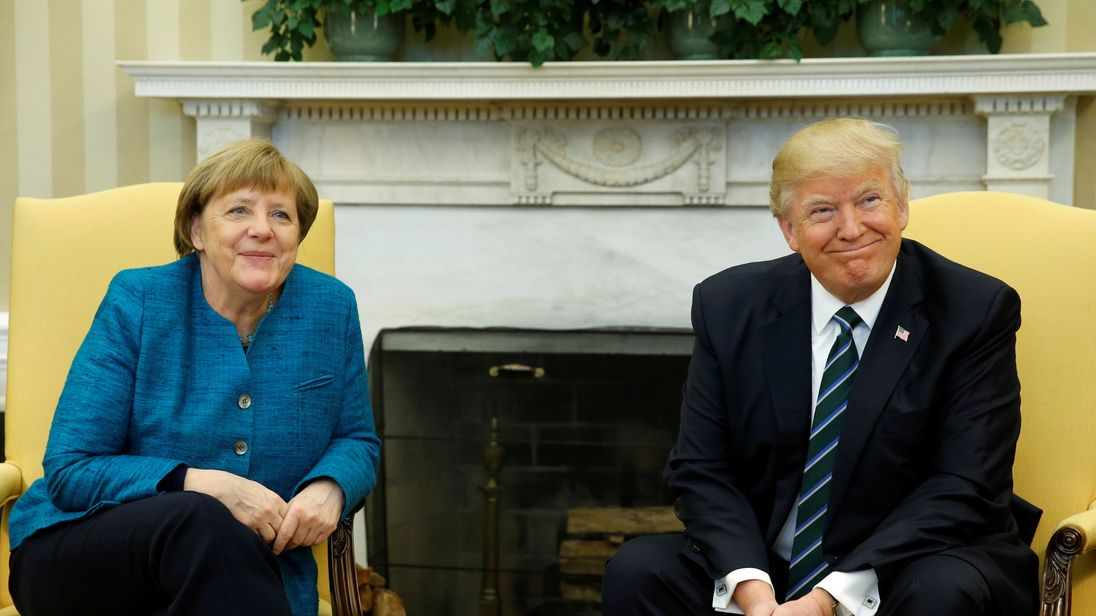 Angela Merkel and Donald Trump smile for the cameras in the Oval Office
