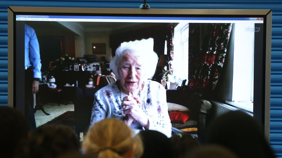 Dame Vera talks to pupils at her old school in east London