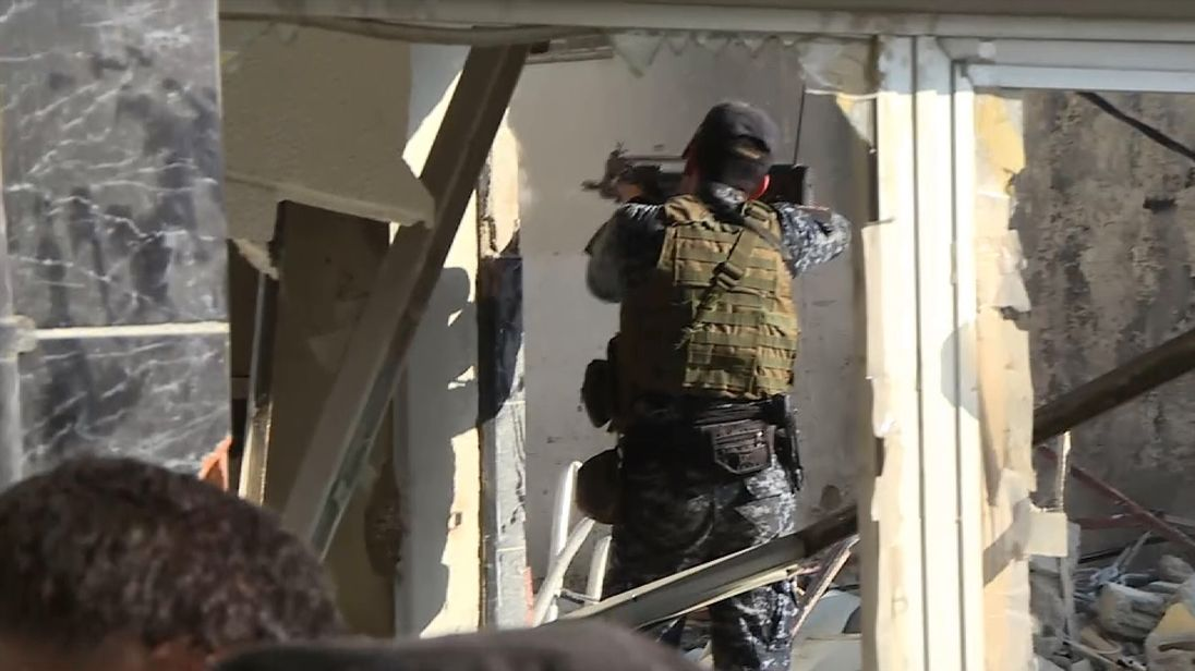 A member of the Iraqi army fires on Islamic State fighters