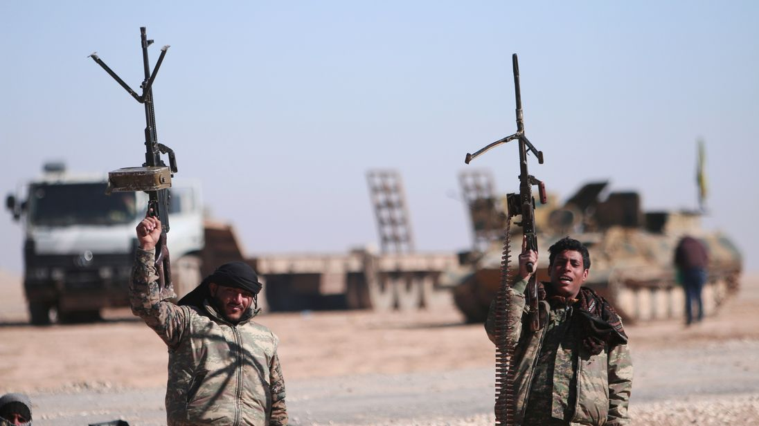 Syrian Democratic Forces soldiers gesture as they close in on the IS stronghold of Raqqa