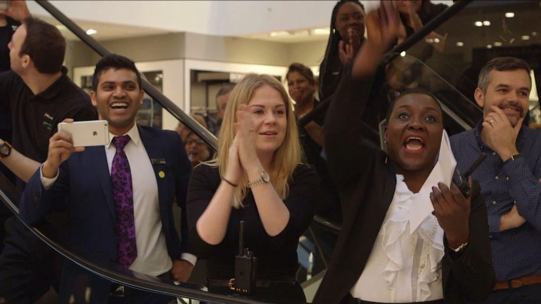 John Lewis staff cheer their bonus award in 2016