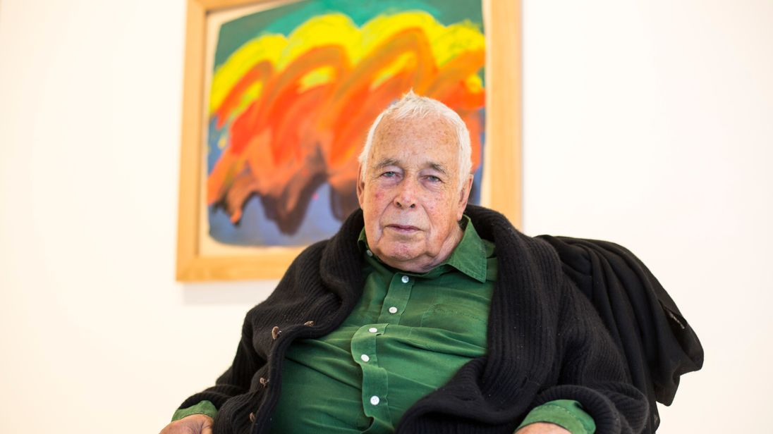 Sir Howard Hodgkin sits for his Indian Waves painting at the Gagosian Gallery