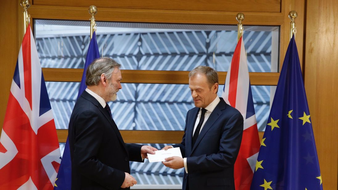 Donald Tusk receives the letter from Britain's EU ambassador, officially triggering Britain's withdrawal from the EU.