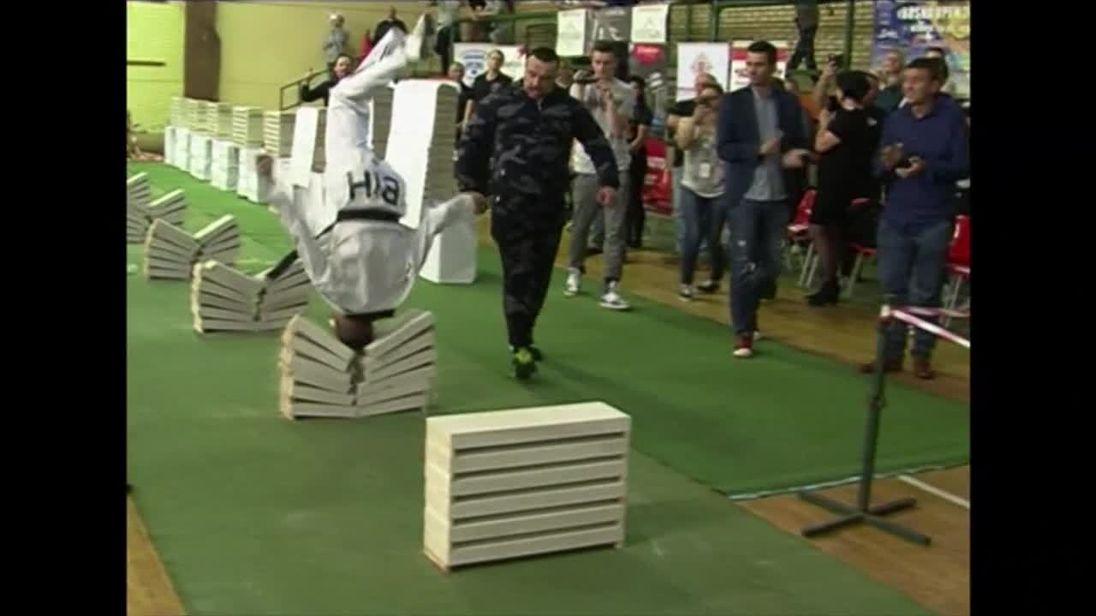 Bosnian taekwondo champion Kerim Ahmetspahic breaking building blocks with his head