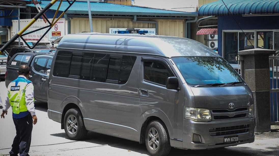 A van believed to be carrying Kim Jong-Nam leaves the hospital in Malaysia