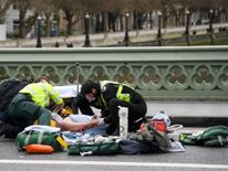 Paramedics treat an inured person after an incident on Westminster Bridge
