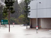 Flood waters enter in the parking lot outside the Robina Hospital on the Gold Coast